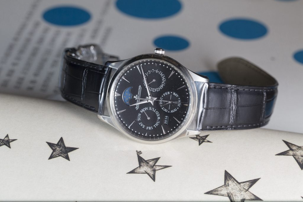 The male replica watches have black dials and black leather straps.