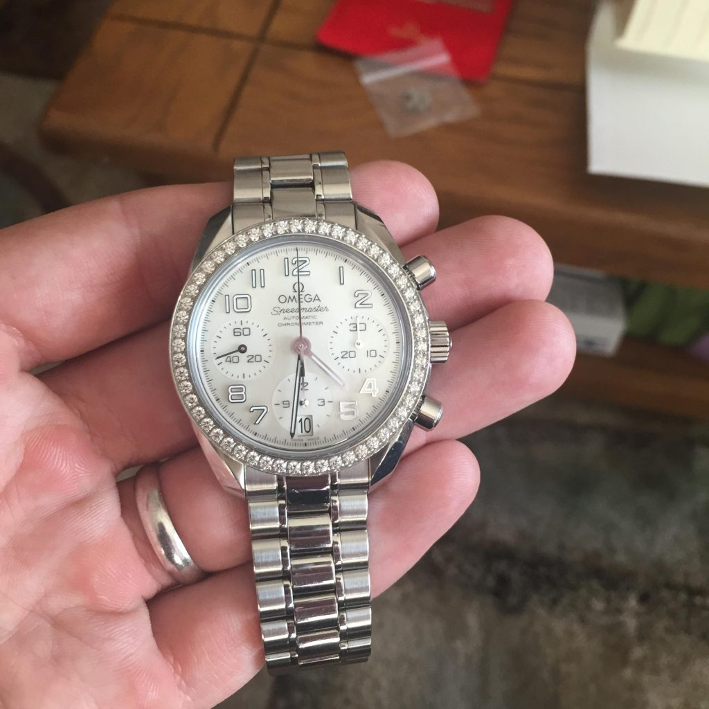 The stainless steel fake watches are decorated with diamonds.